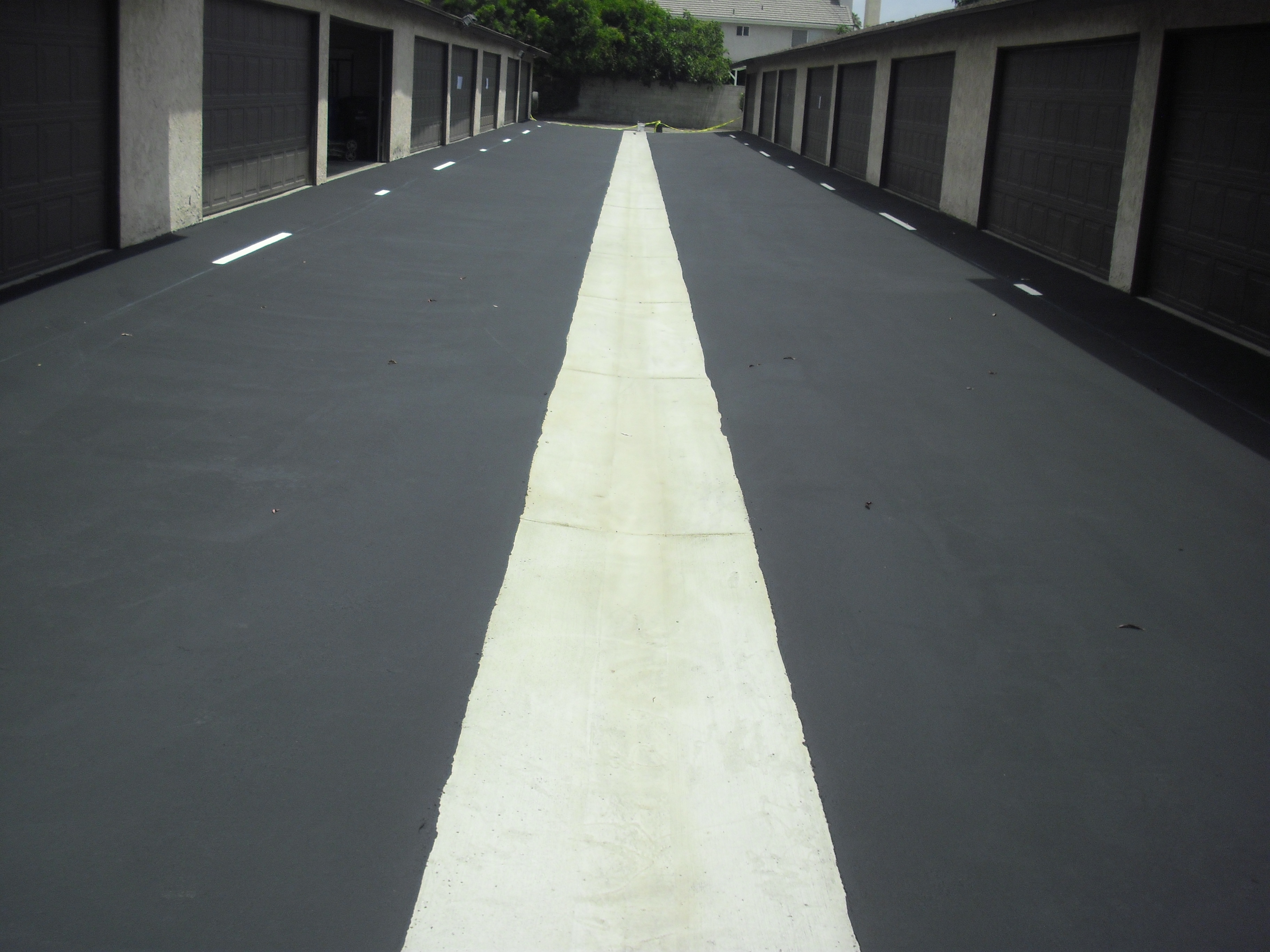 New Asphalt Pavement and Concrete Swell